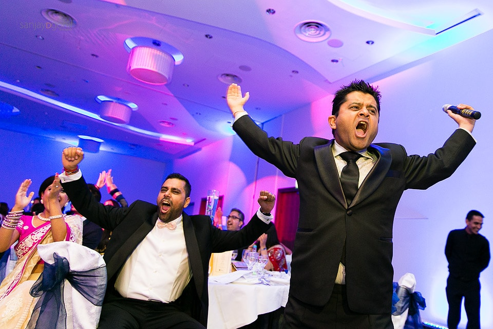 Reception party guests cheering