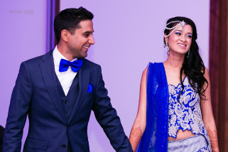 Arrival of Bride and Groom at Asian wedding reception party