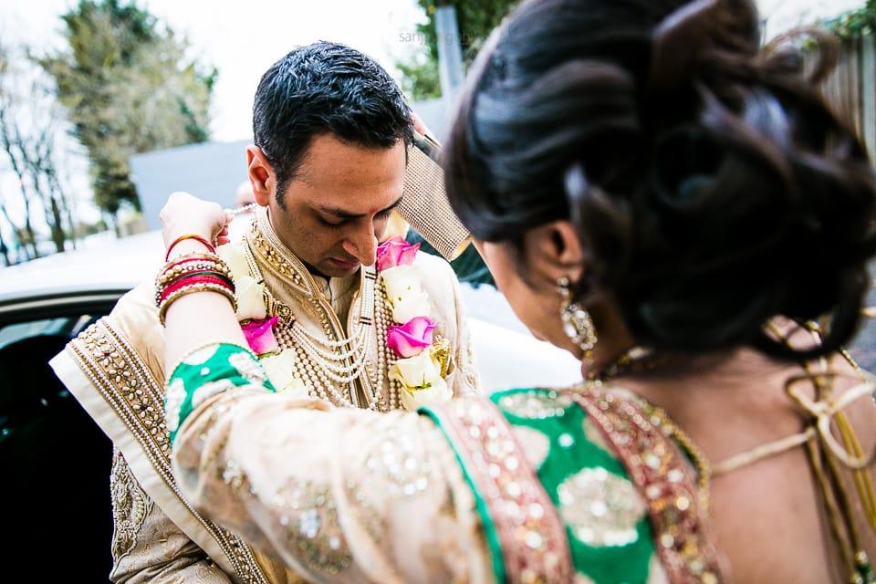 Hindu Wedding Groom being garlanded