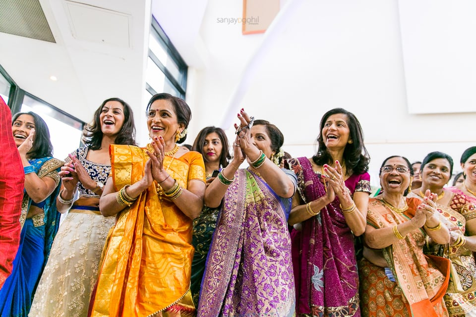 Asian wedding guests laughing