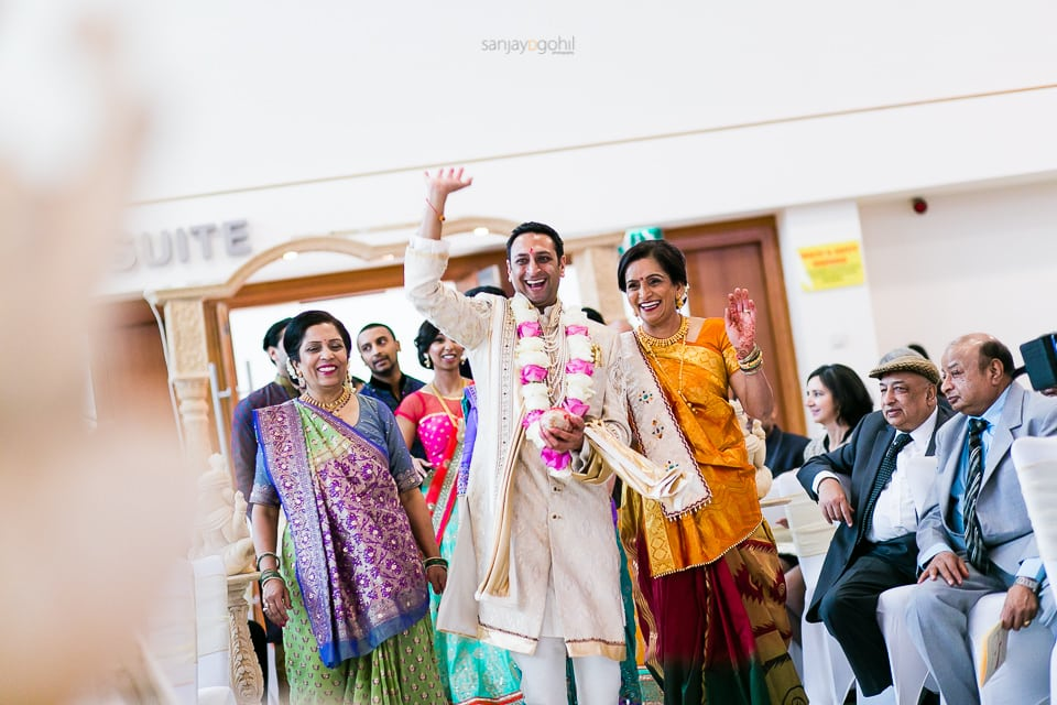 Hindu wedding groom dancing as he arrives