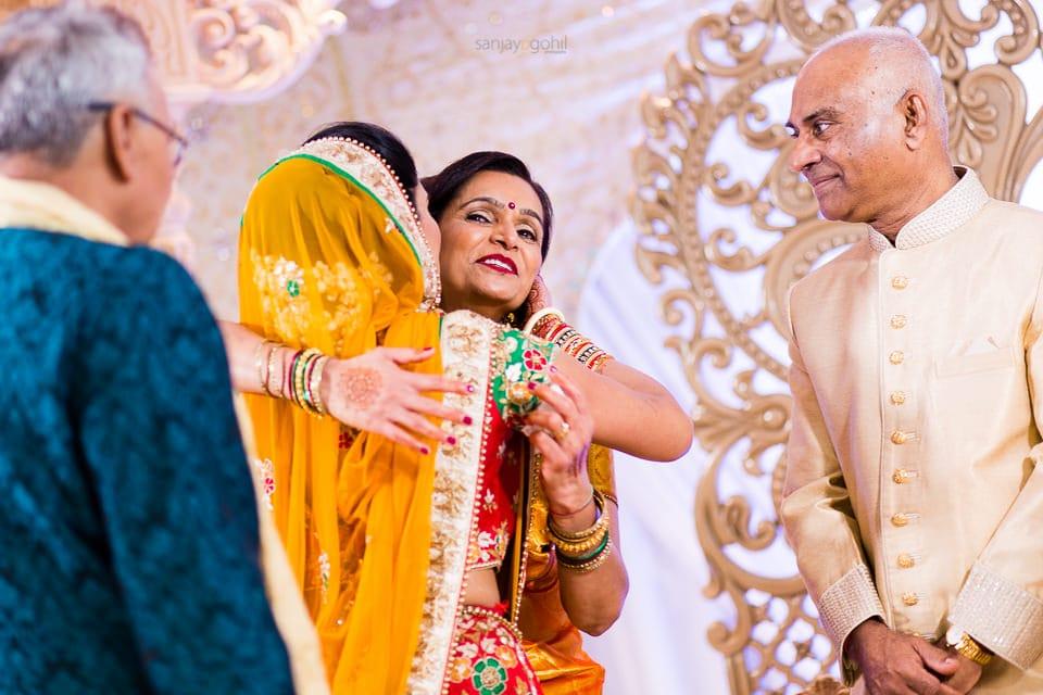 Hindu Wedding Bride hugging mother
