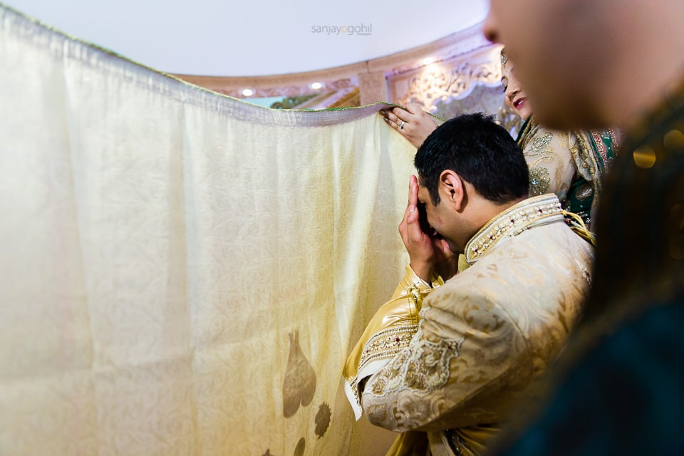 Asian Wedding groom being the antaphat