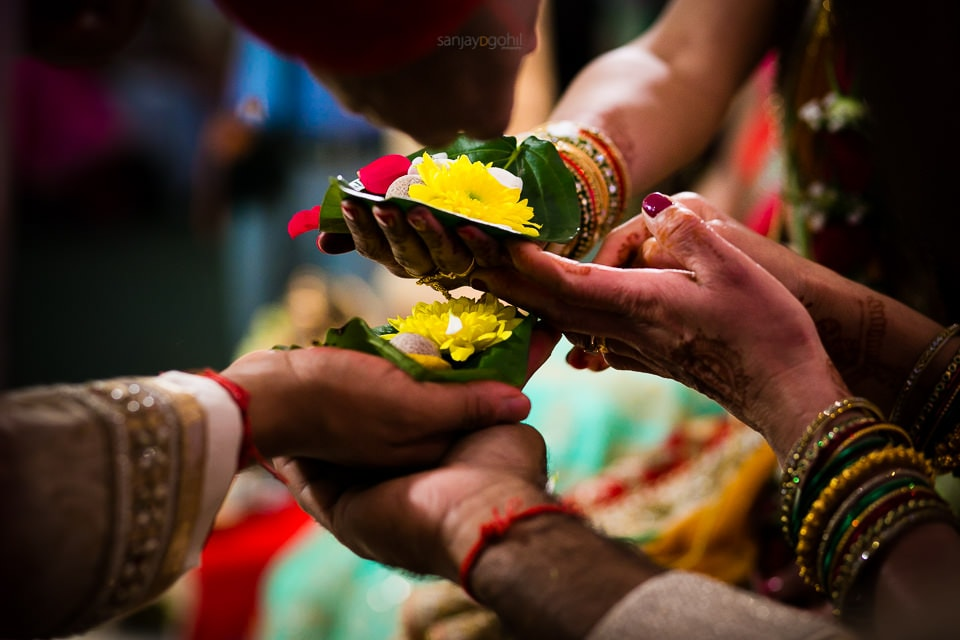 Closeup of hands during kanya dhan ceremony