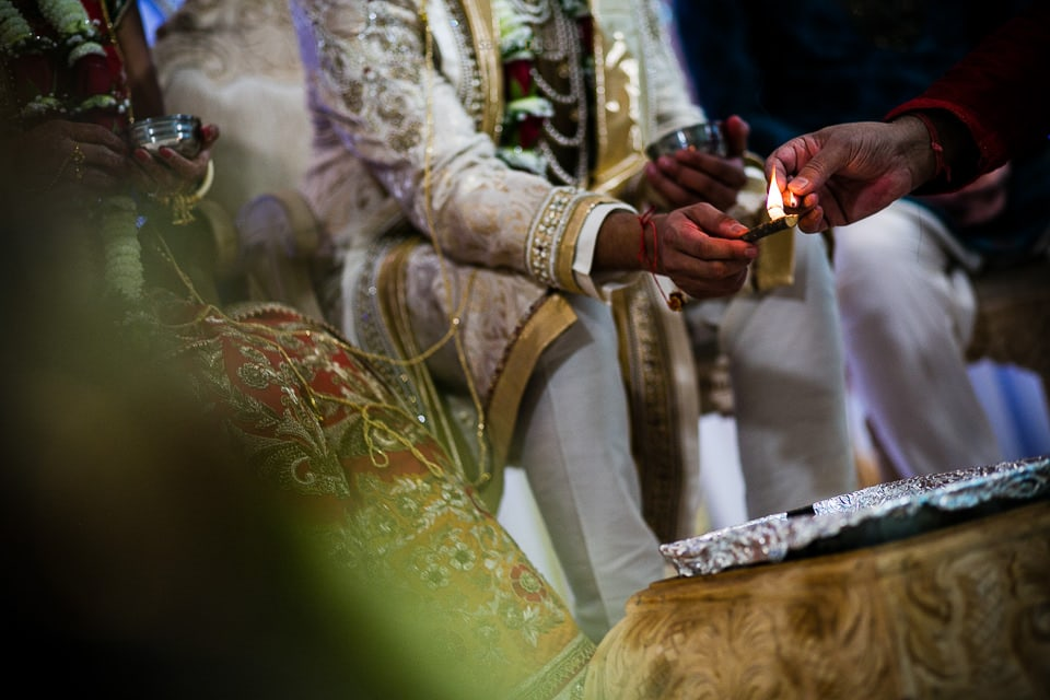 Groom lighting the fire during Hindu Wedding ceremony
