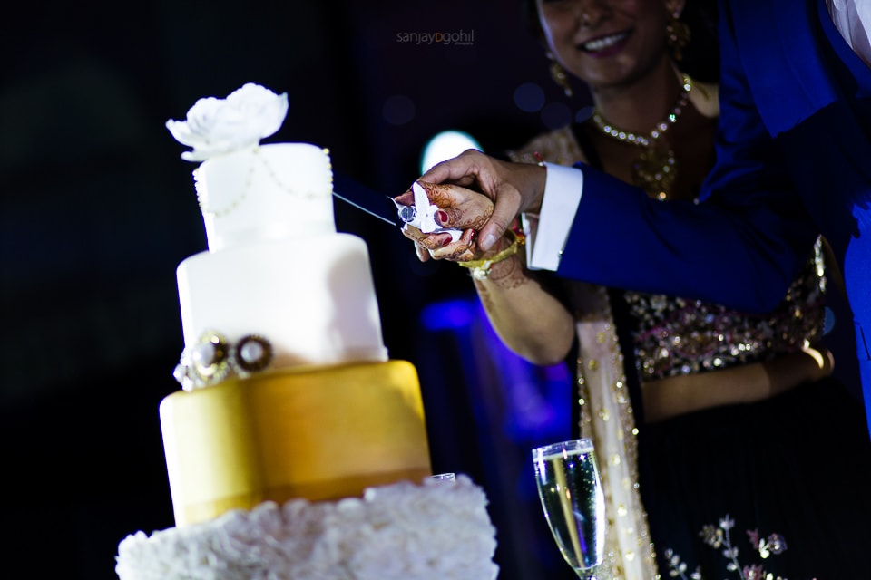 Asian wedding cake being cut