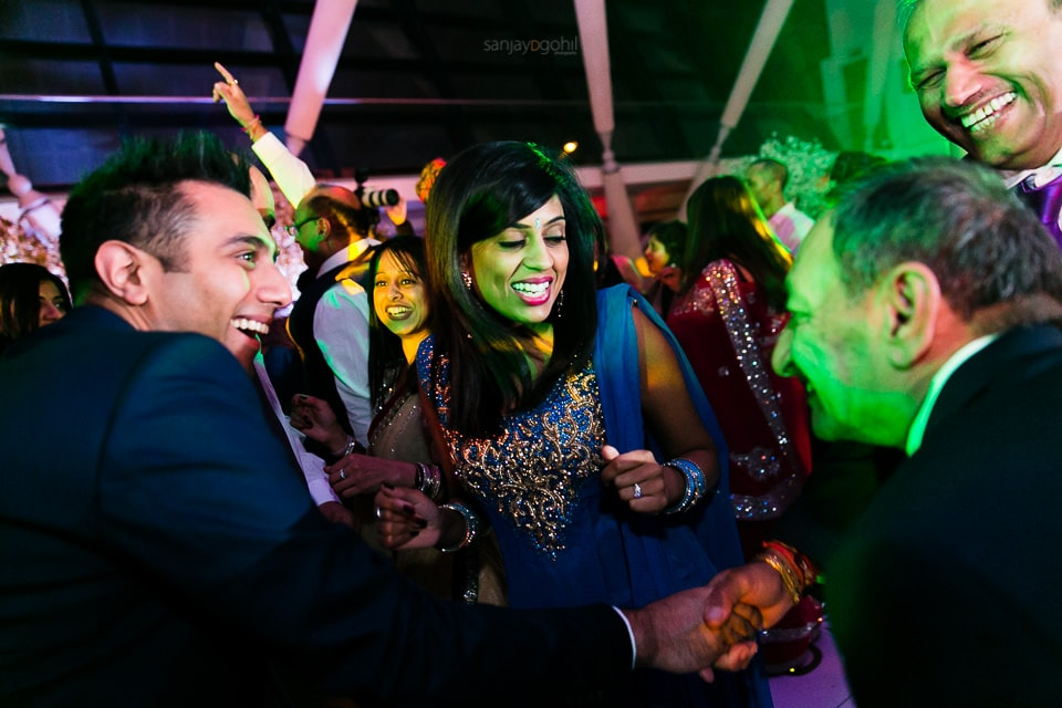 Wedding guests dancing during reception party at Sattavis Patidar centre