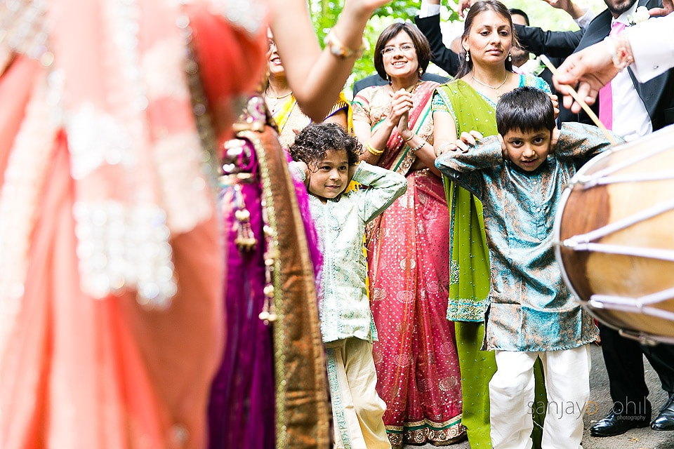 Small children blocking their ears during the groom's arrival