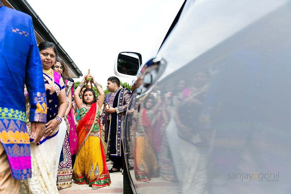 Reflection of Hindu Wedding guests as they great the groom