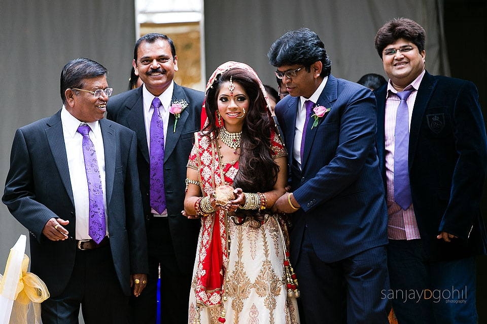 Asian Wedding Bride being walked up the isle