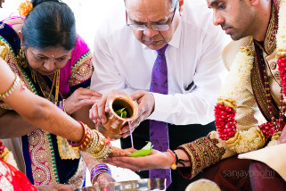 Water being poured onto the hands of the bride and groom during Hindu wedding ceremony