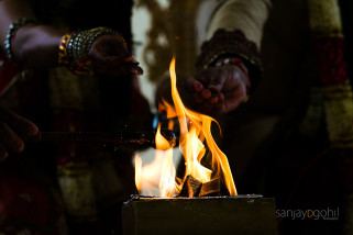 Seeds being offered in to the fire during Hindu Wedding ceremony
