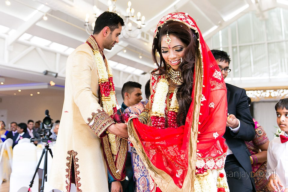 Asian Wedding Bride leading the Phera