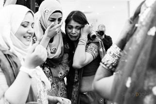 Wedding guests crying as bride leaves