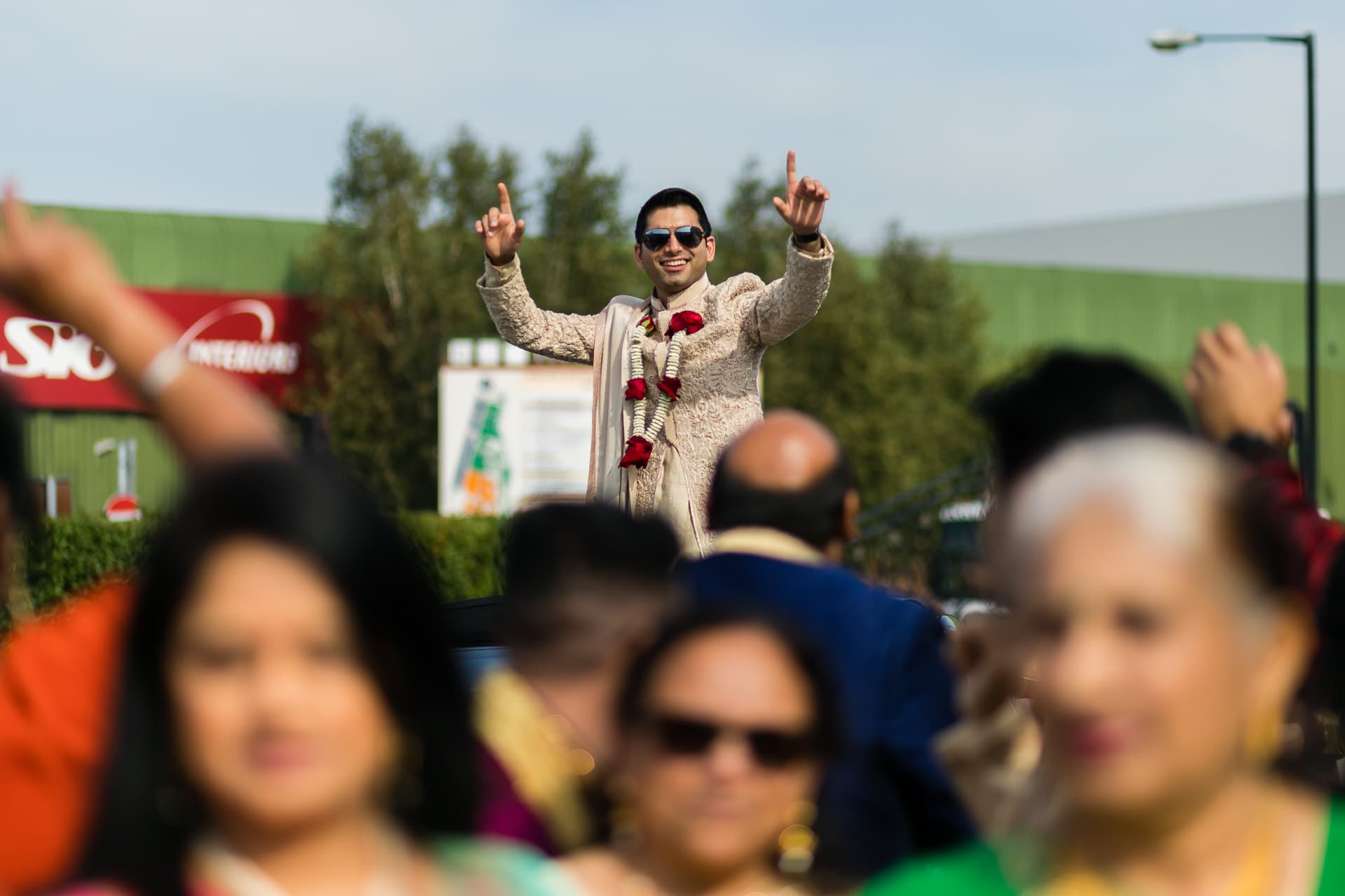 Groom's arrival for Asian wedding
