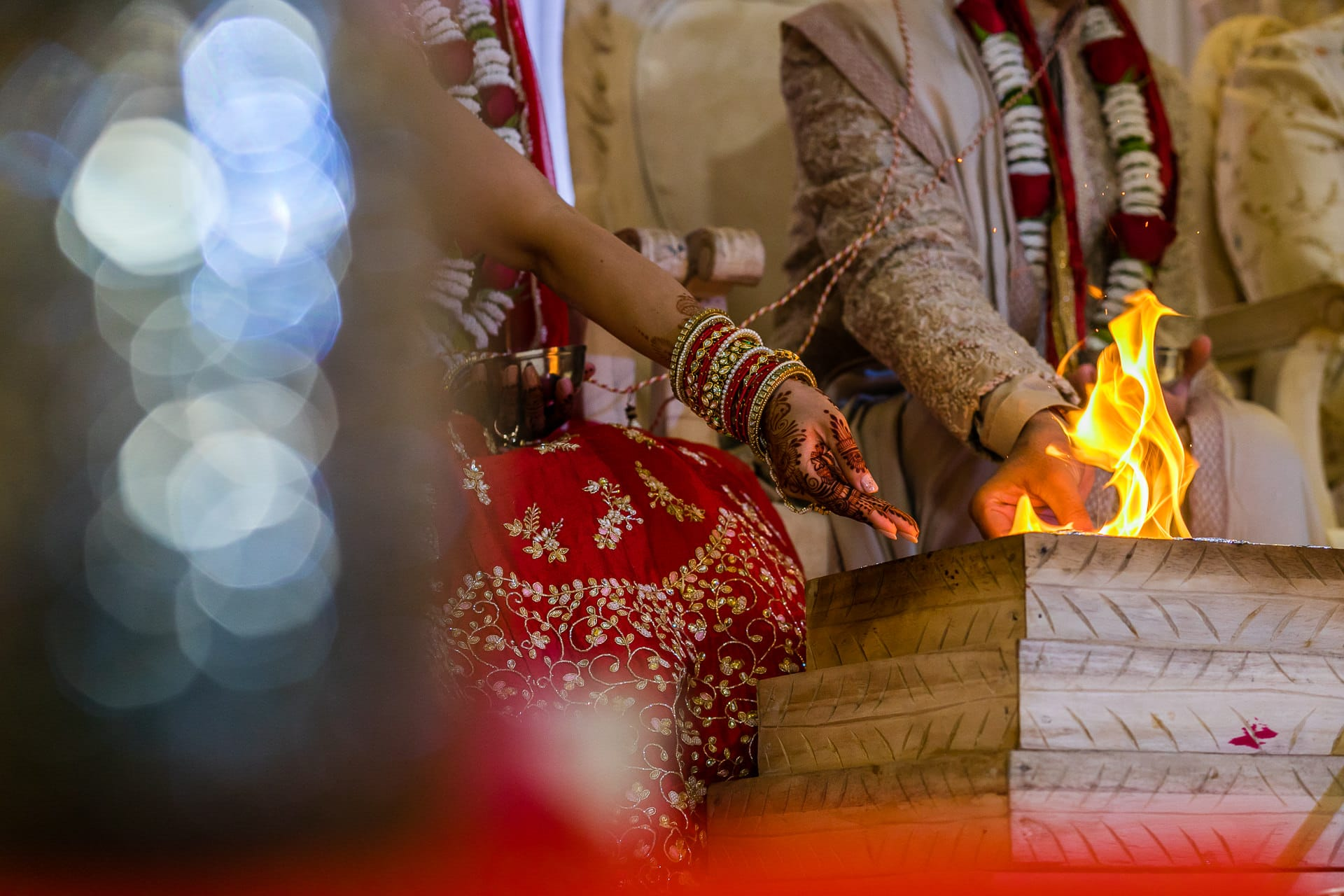 Bride pouring seeds into the fire