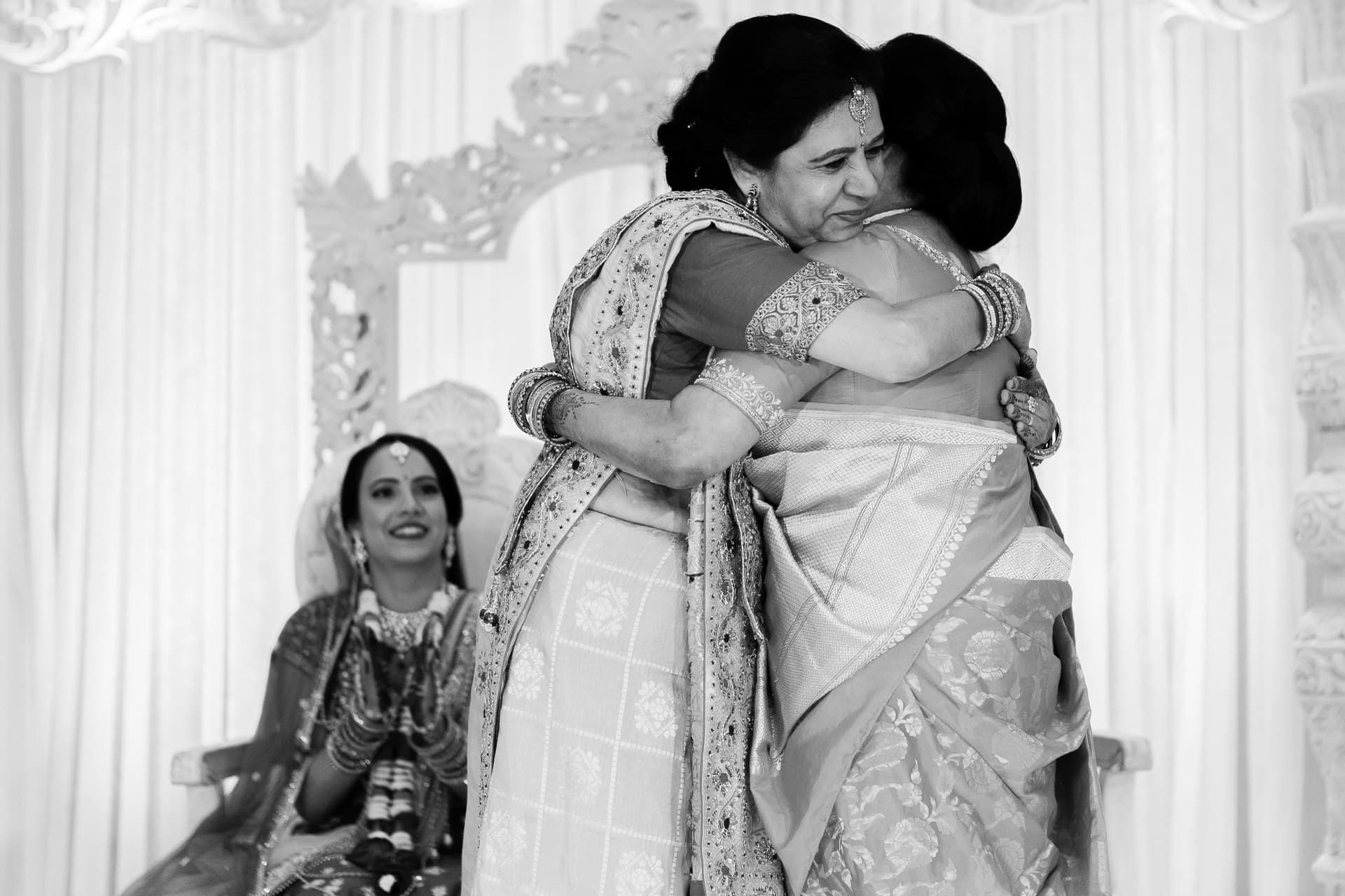 Mothers of bride and groom hugging