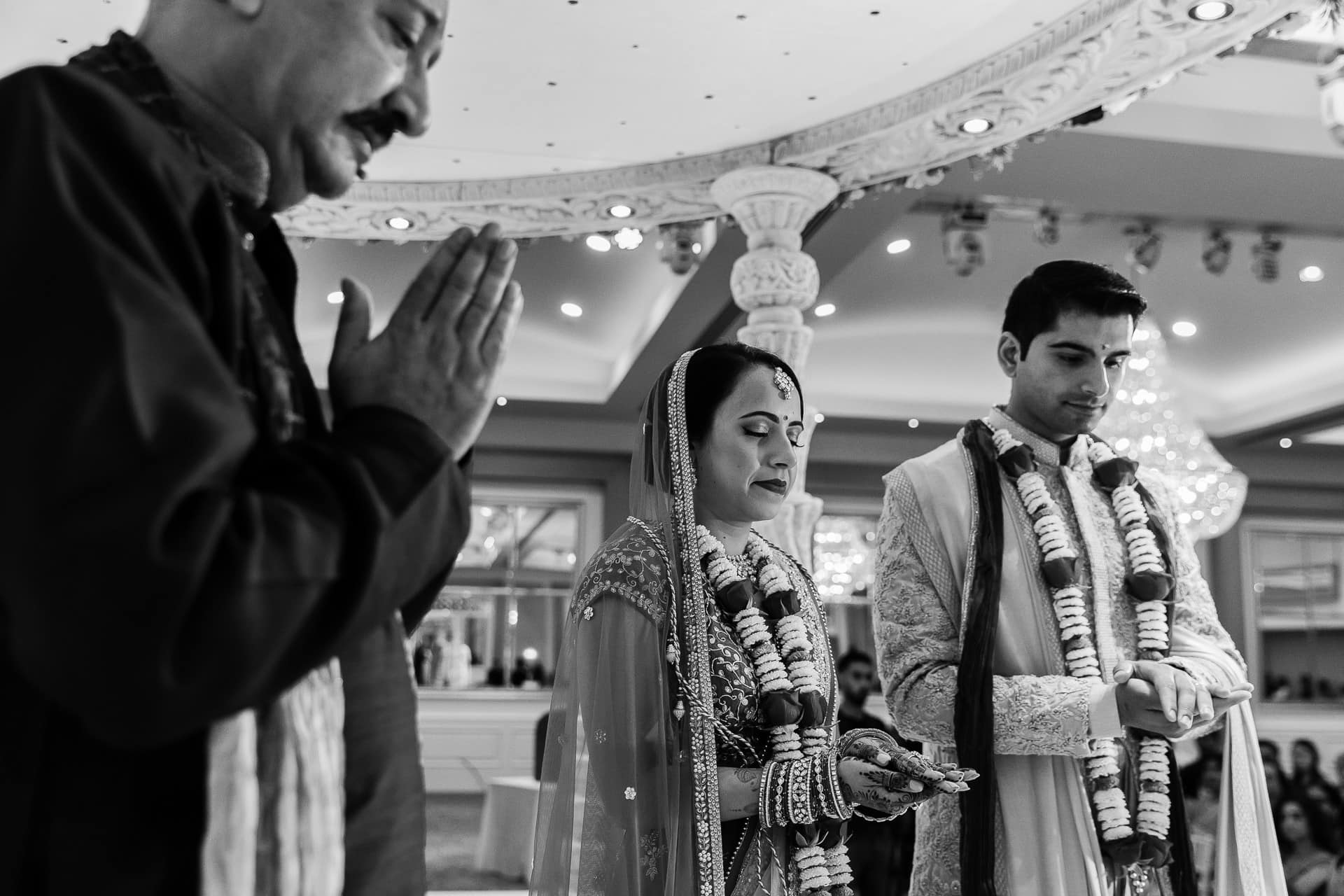 Final prayers during Asian wedding ceremony