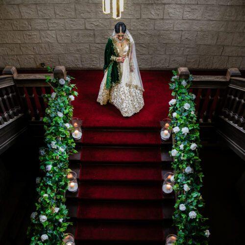 Bride walking to asian wedding at Newland Manor
