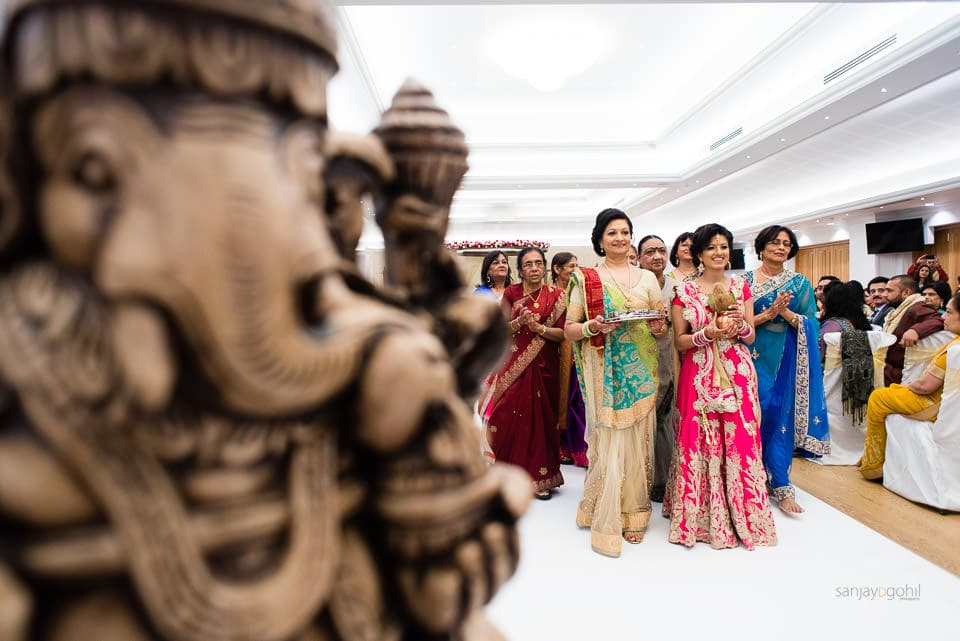 Brides family walking to greet the groom, decor by Gayatri Mandaps