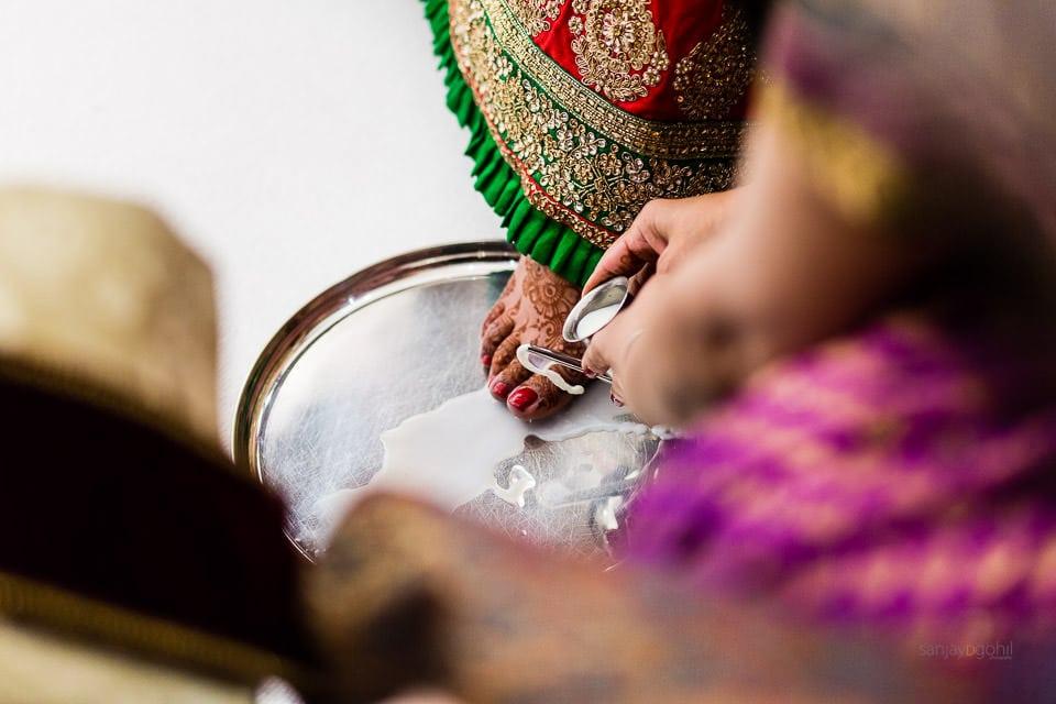 Feet washing ceremony during asian wedding