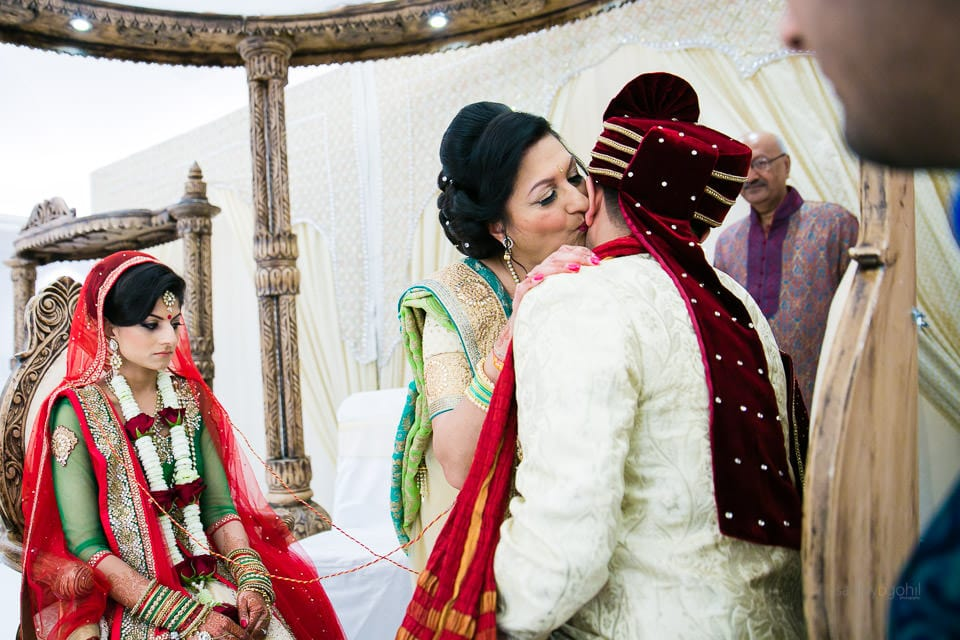 Mother of the bride kissing the groom