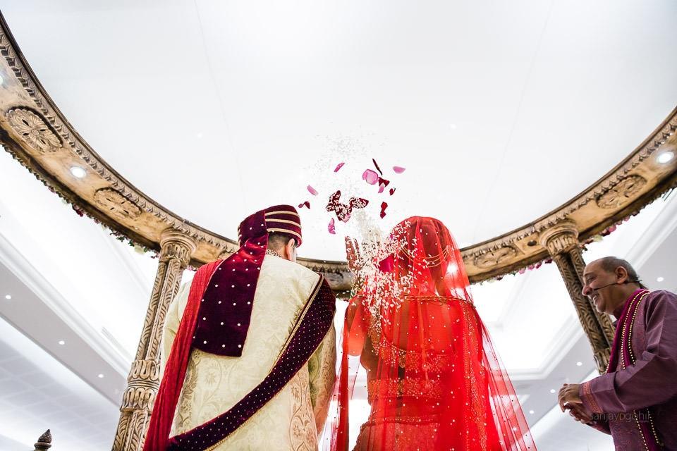 Bride throwing flowers behind her