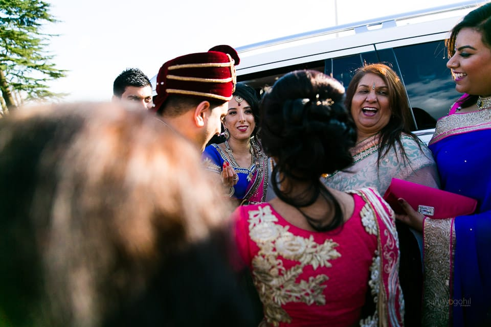 Groom's sisters stopping bride and groom from getting into the car