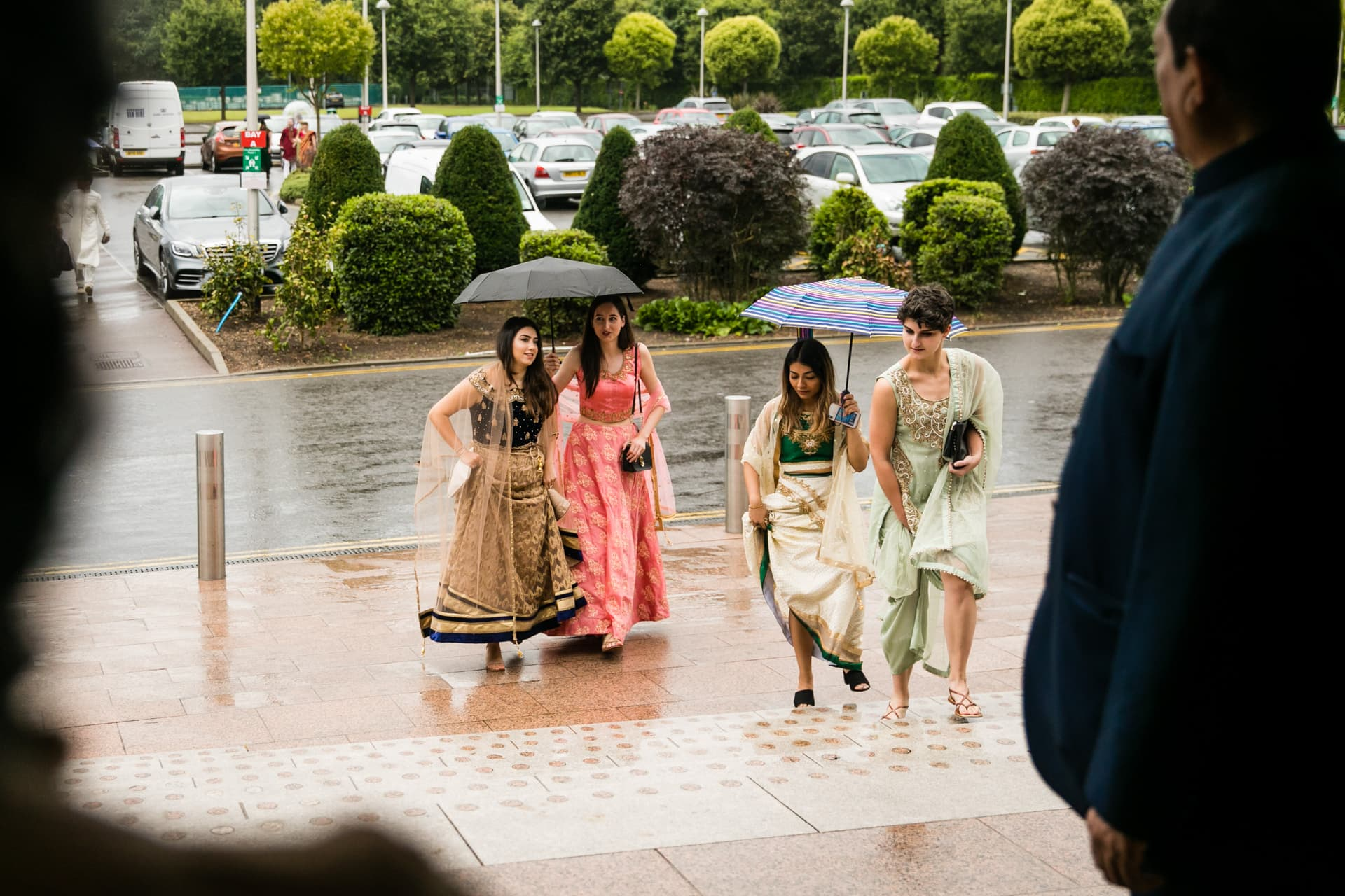 Asian wedding guests arriving at Oshwal centre