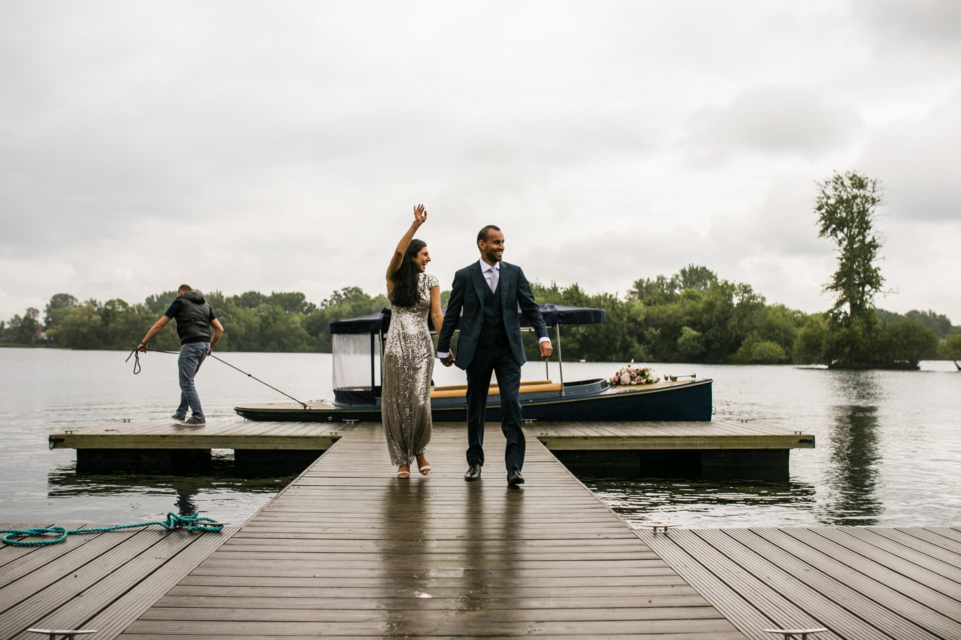 Bride and groom arriving by boat