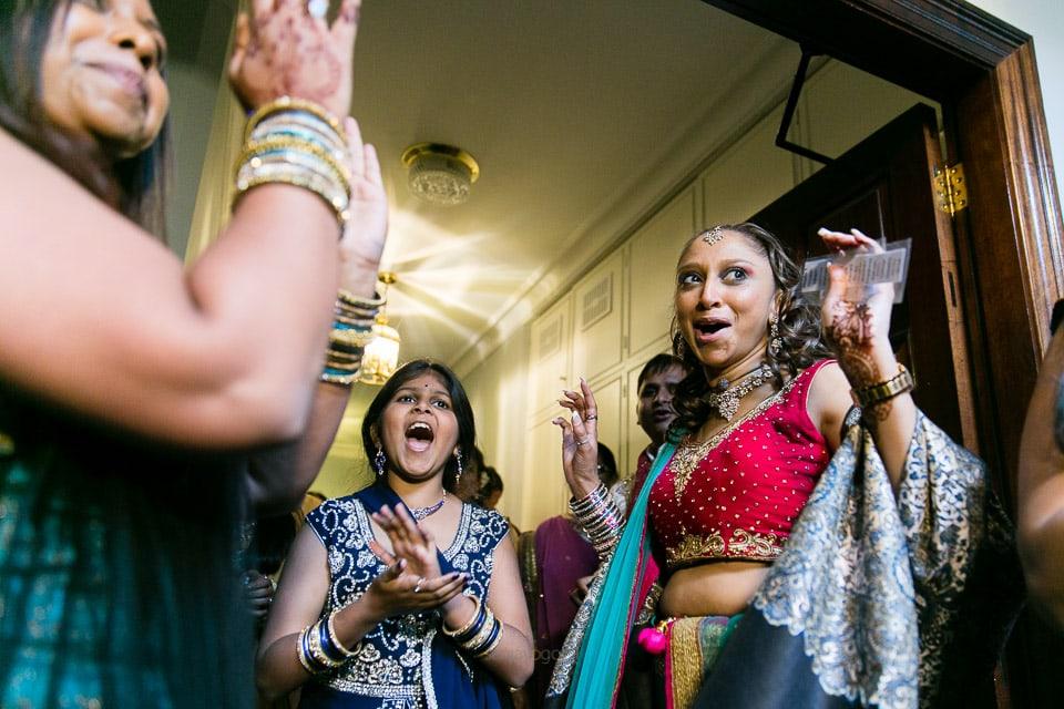 Hindu Wedding guests laughing and dancing