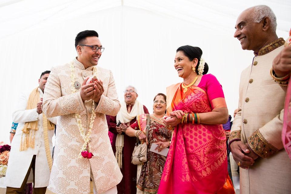 Asian wedding groom walking into the mandap
