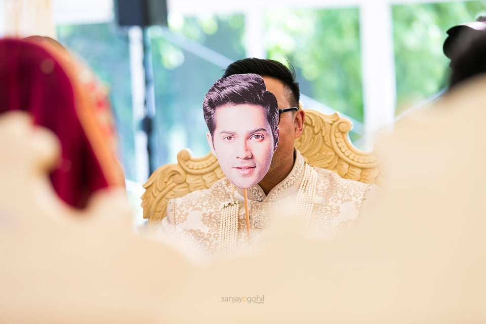 Groom with mask infront of his face
