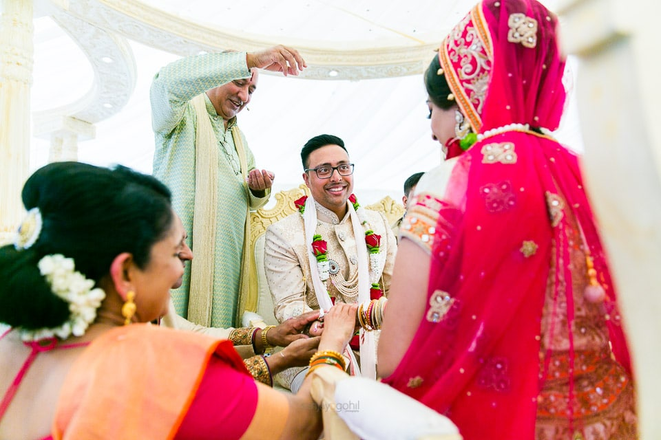 Hindu wedding ceremony being conducted by Vasudev Mehta