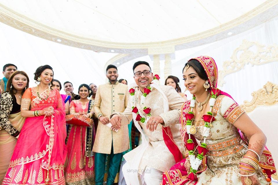 Hindu wedding bride sitting down before groom