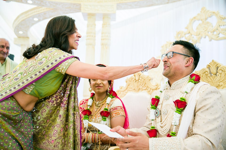 Groom's nose bieng pinched during Hindu Wedding ceremony