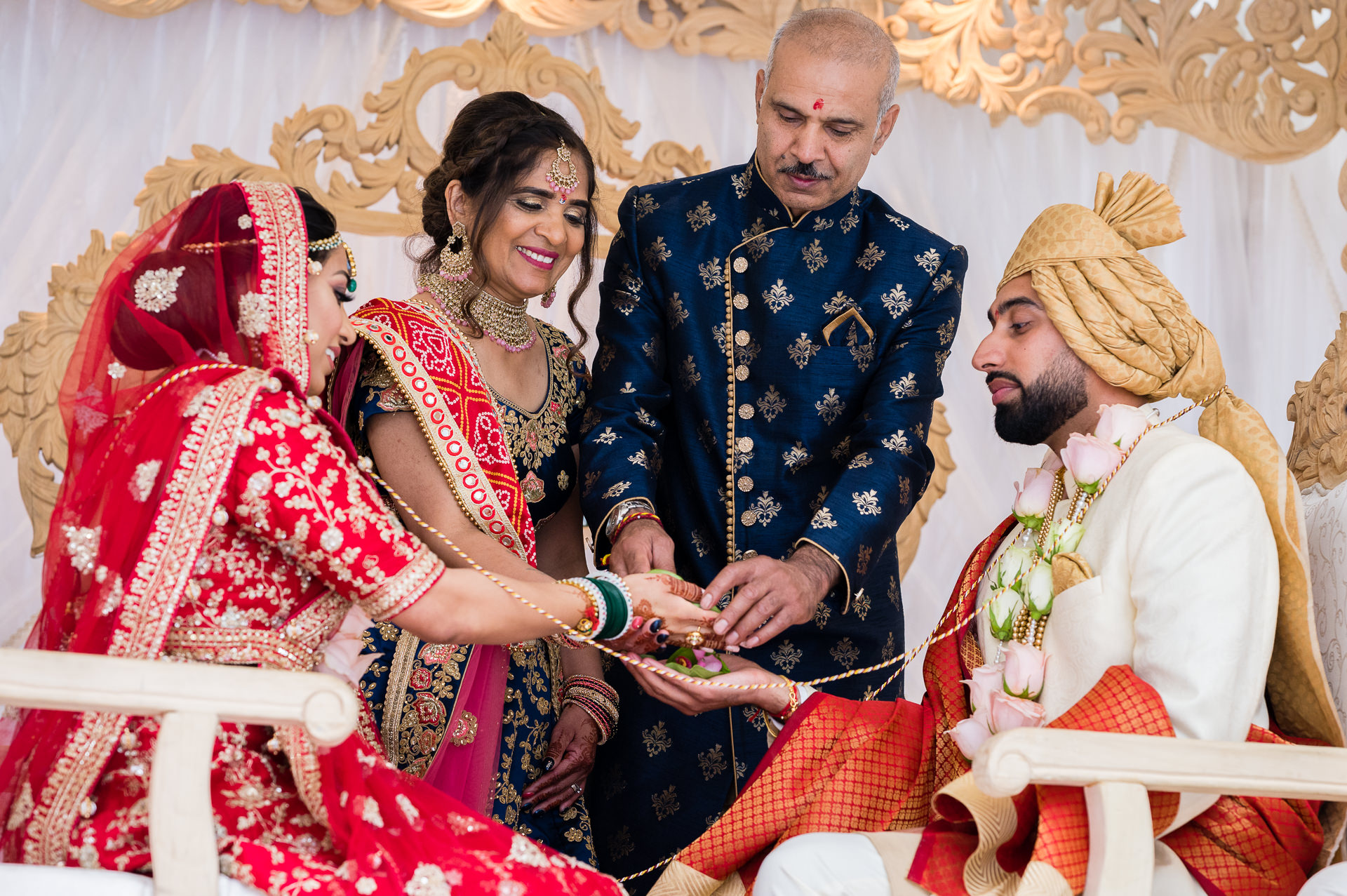 Parents of the bride giving hand away in marriage