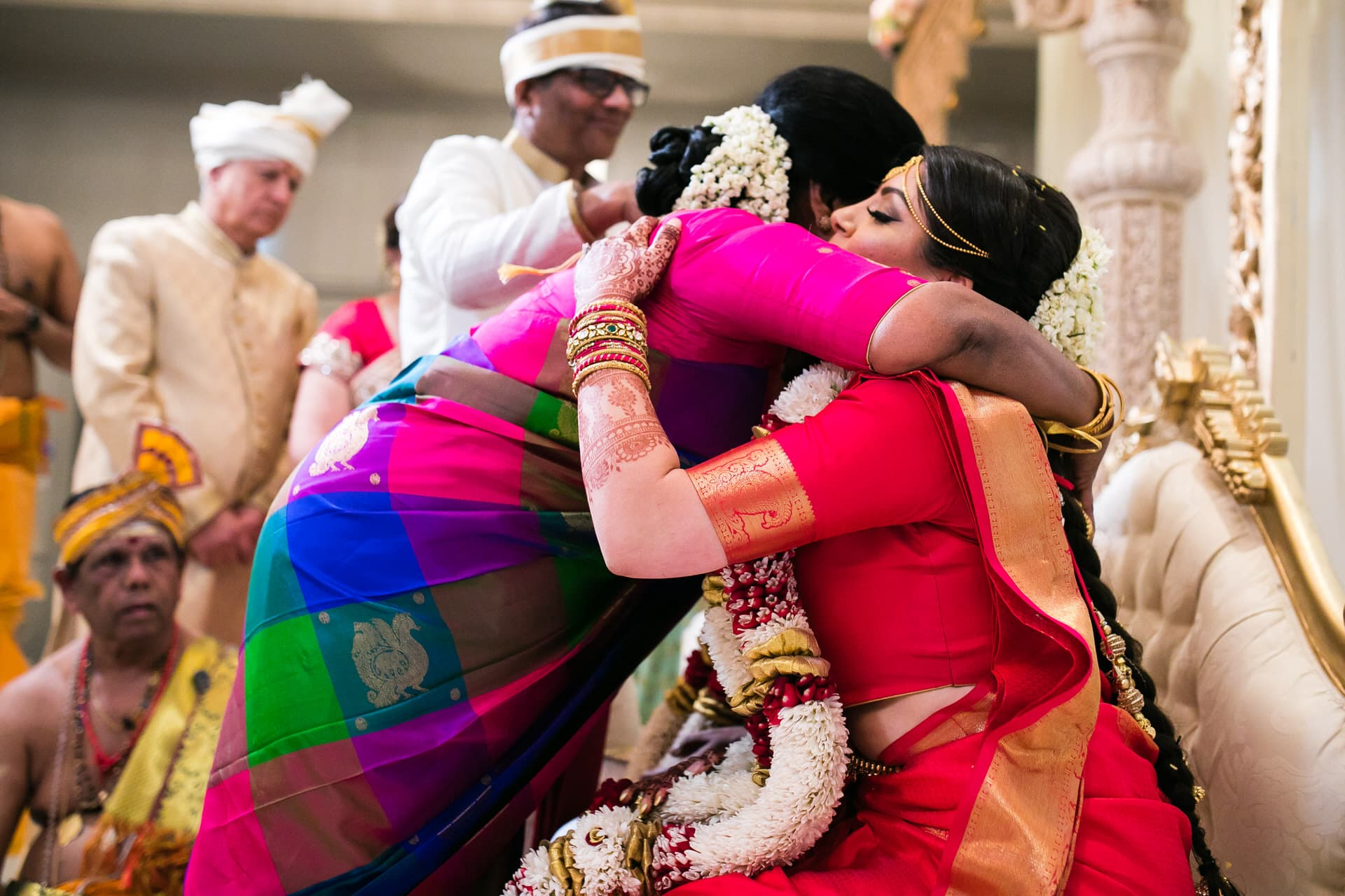 Grooms mother hugging bride