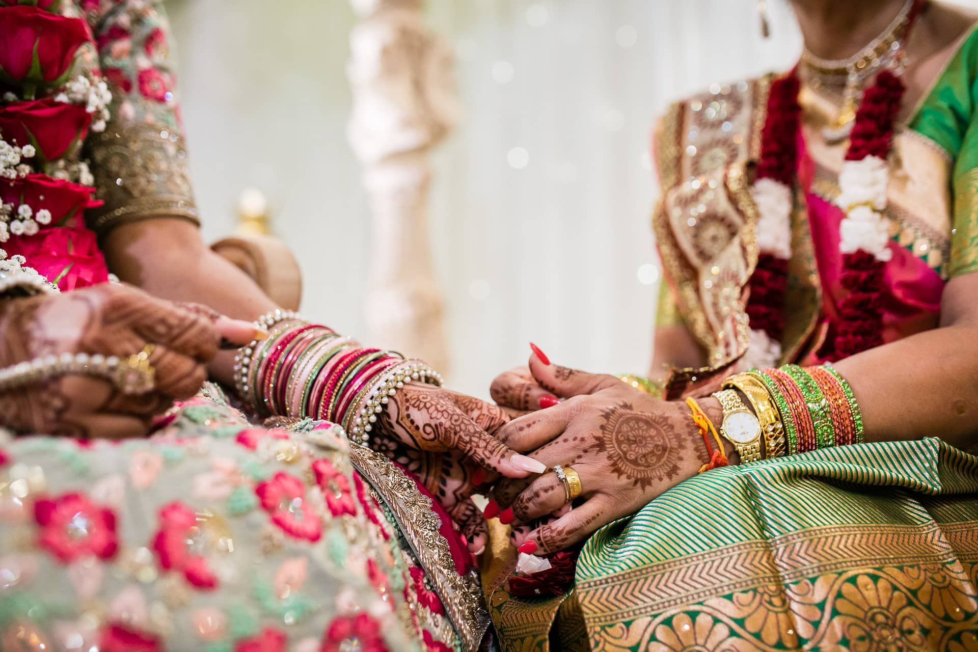 bride and mum holding hands