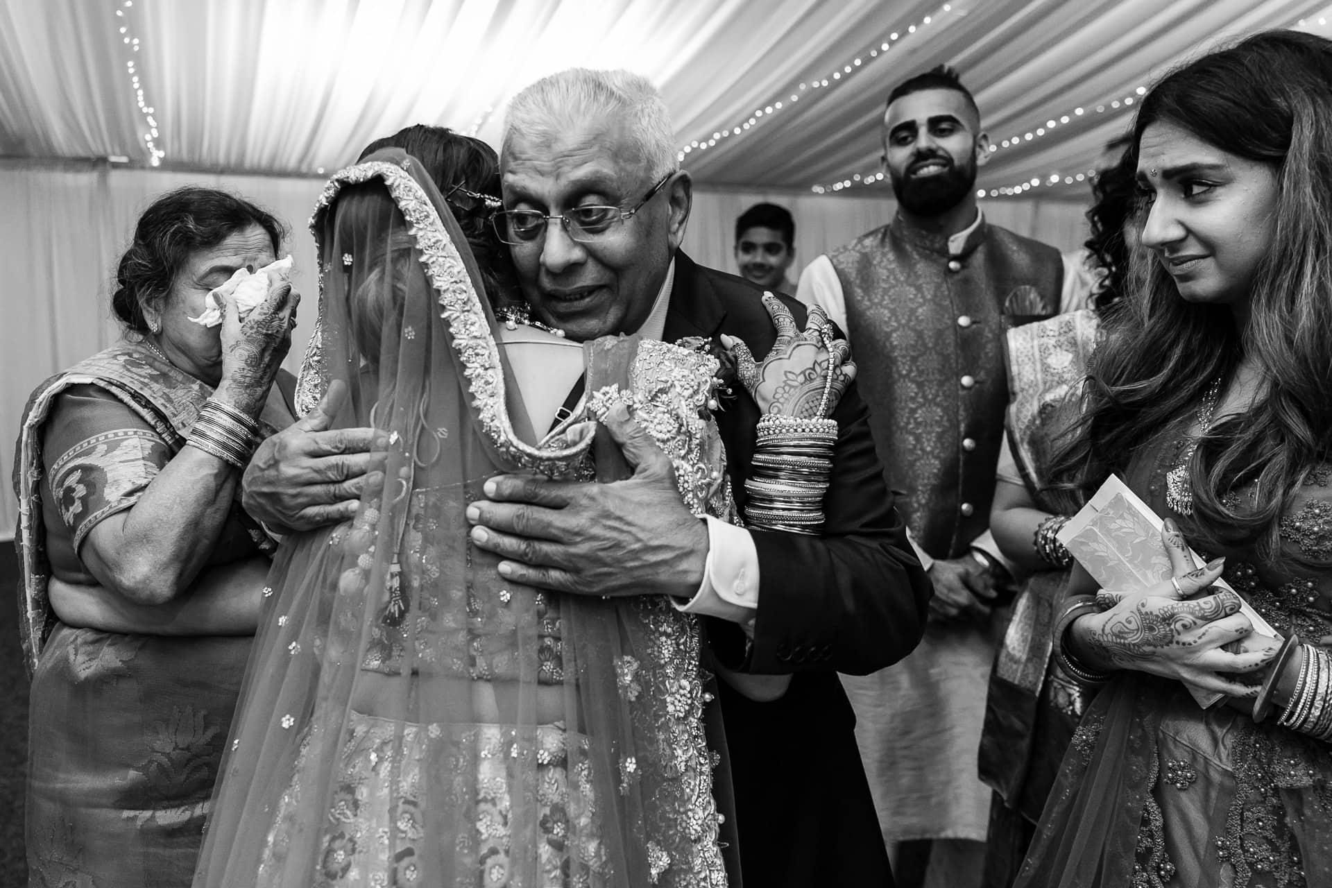 Bride hugging grand father during Vidhia