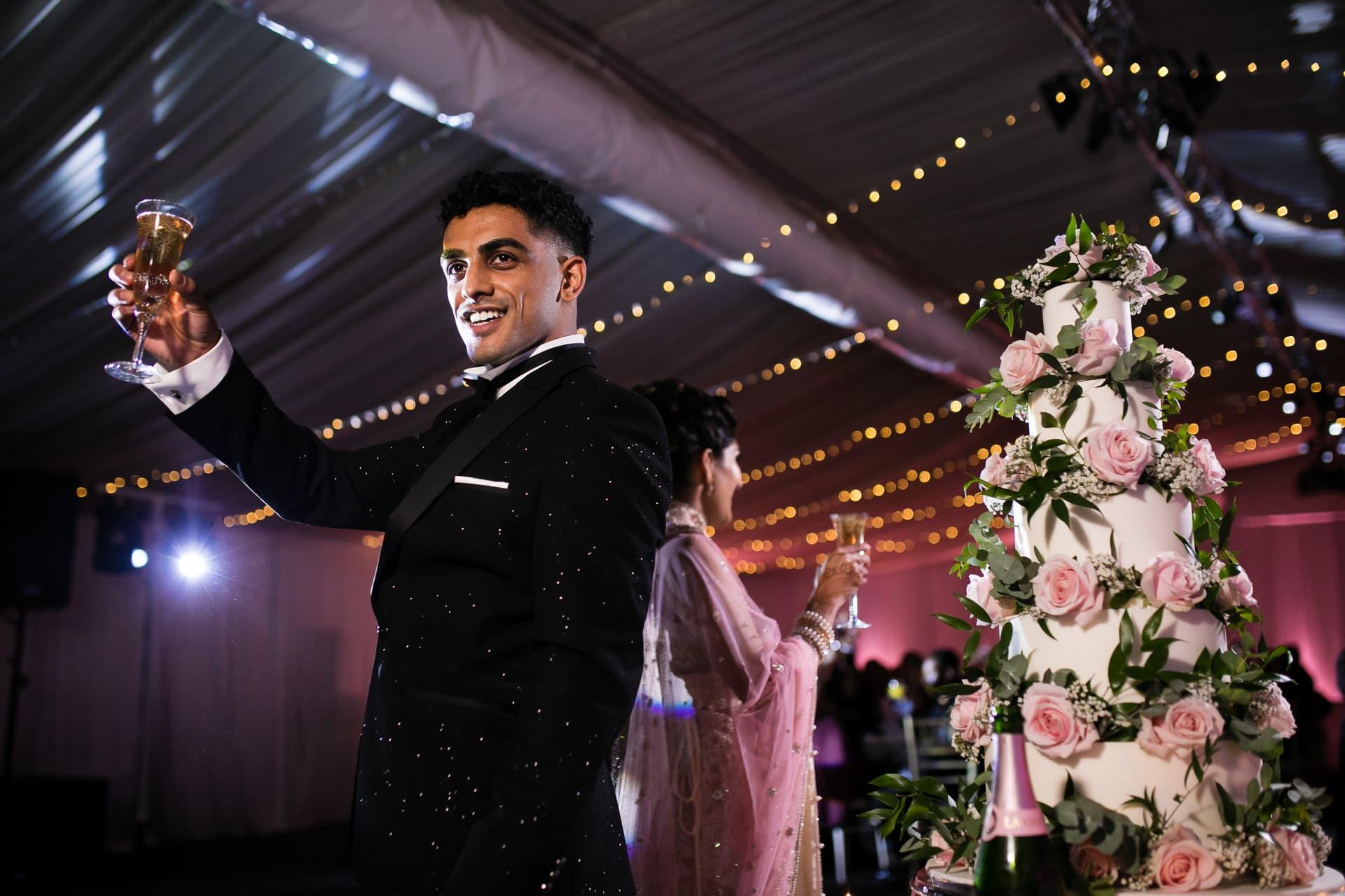 Groom toasting wedding guests